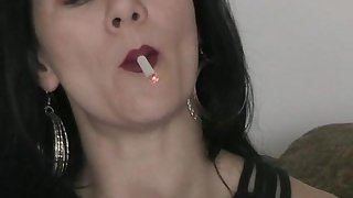 Solitary brunette smoking after a long time masturbating aid of a gewgaw in closeup shoot