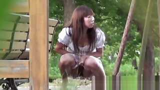 Tantalizing Japanese in dame peeing behindhand canteen in park