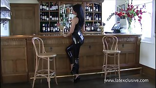 Latex bartender Sarahs catsuit service with the addition of glamour brunette